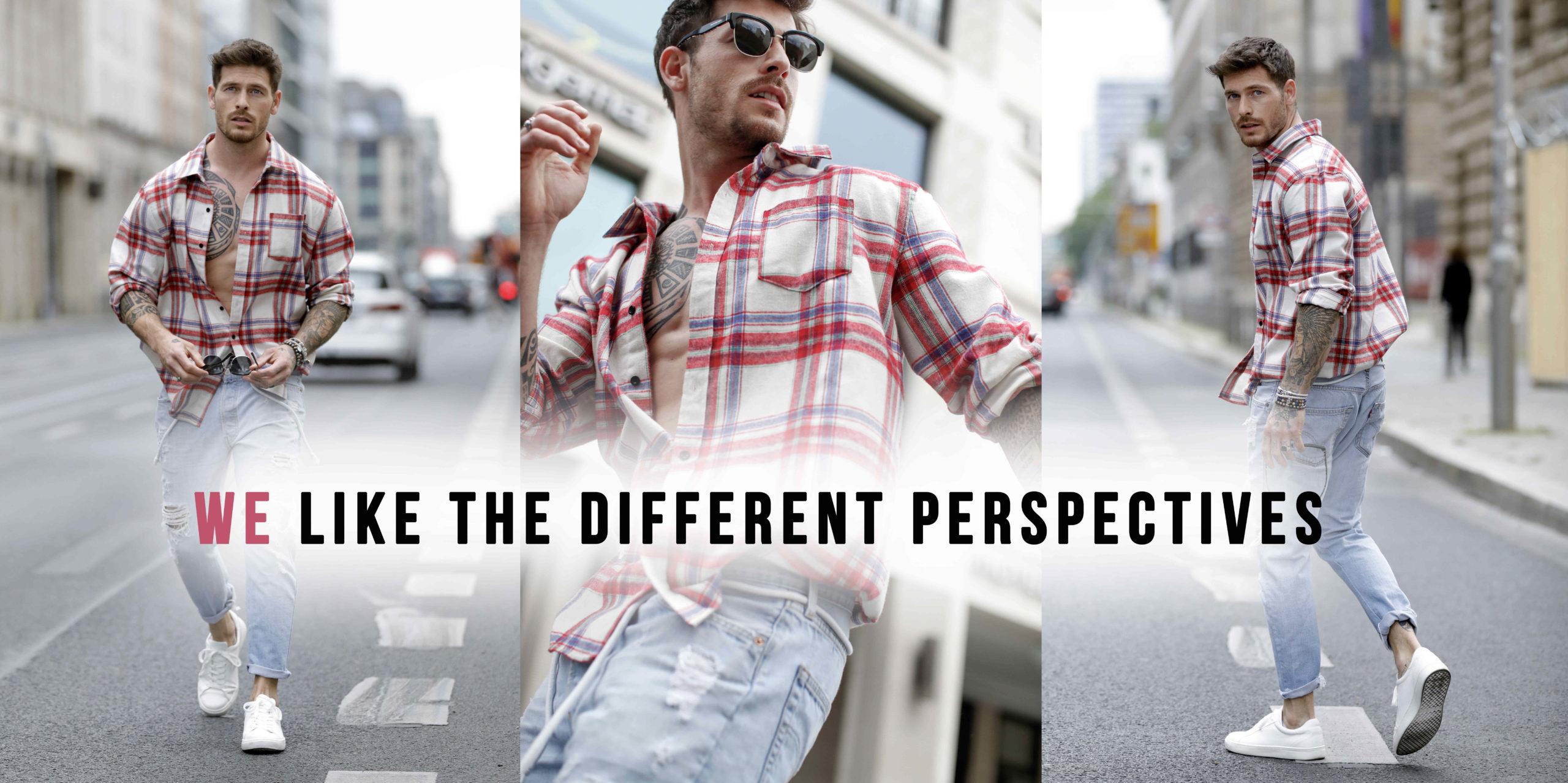 Influencer Angelo Carlucci trägt eine Jeans, ein rot-weiss kariertes Hemd und weisse Sneakers